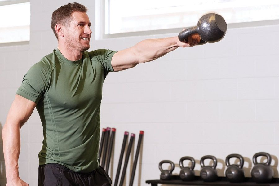 Young Man Workout With Kettlebell