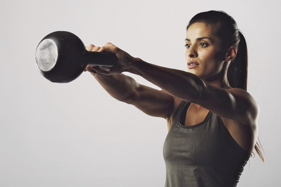 Young Woman Workout With Kettlebell
