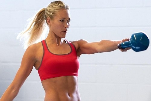 Woman Workout With Kettlebell