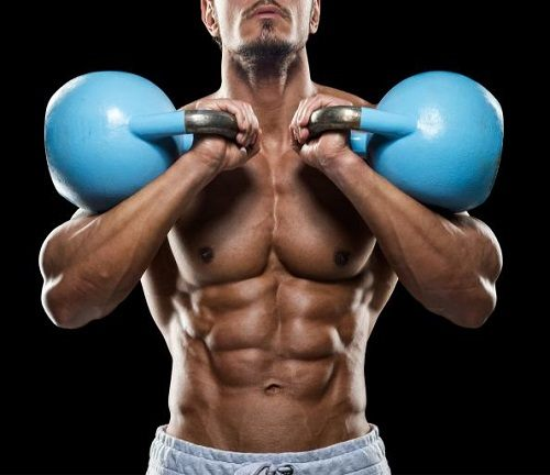 Man with Amazing Abs Working Out with Kettlebells