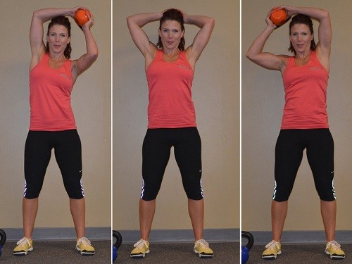 Woman Doing a Kettlebell Halo Exercise