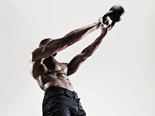 Artistic photo of a Man Doing Kettlebell Workout