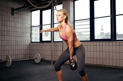 Woman Doing a Kettlebell Exercise