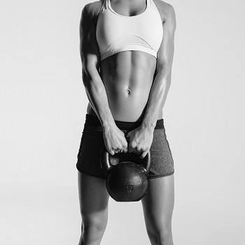 Girl exercising with kettlebell