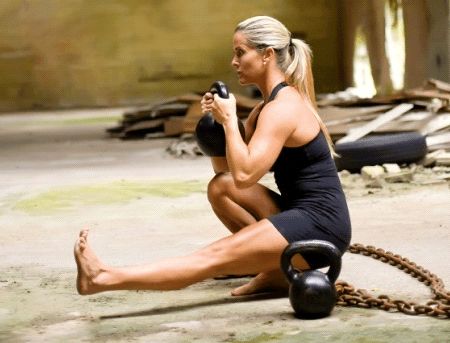 Doing squat with kettlebell
