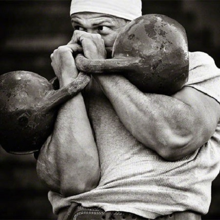Man lifting two kettlebells