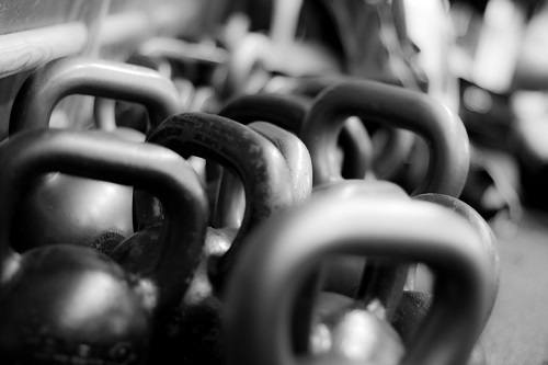Stack of kettlebells in black and white