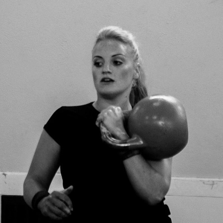 Women lifting kettlebell